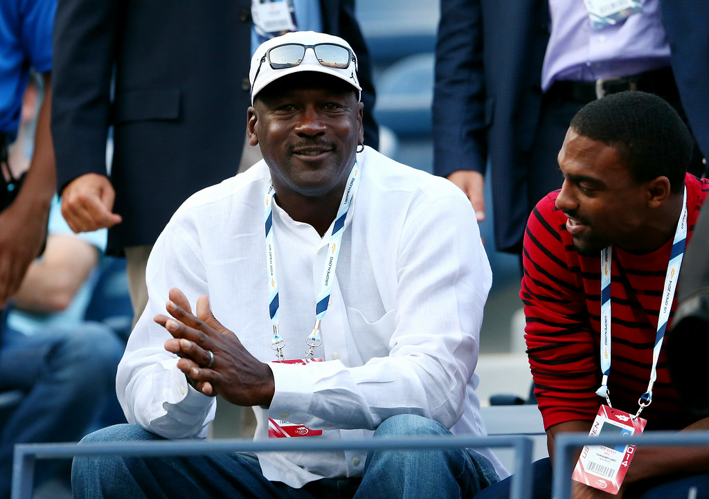 . NEW YORK, NY - AUGUST 26:  Basketball Hall of Famer Michael Jordan watches as Roger Federer of Switzerland plays against Marinko Matosevic of Australia during their men\'s singles first round match on Day Two of the 2014 US Open at the USTA Billie Jean King National Tennis Center on August 26, 2014  in the Flushing neighborhood of the Queens borough of New York City.  (Photo by Elsa/Getty Images)