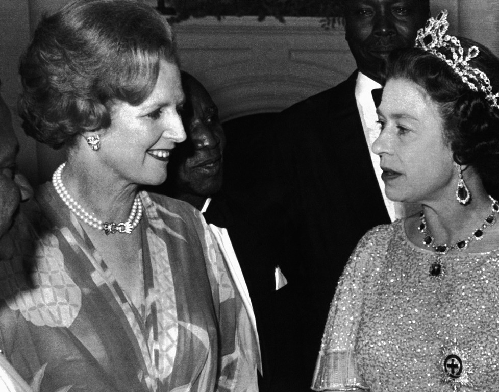 . This is a Aug. 1, 1979 file photo of Britain\'s Queen Elizabeth II talks with British Prime Minister, Margaret Thatcher, left,  at a reception for the 39 heads of delegations attending the Commonwealth Conference in Lusaka, Zambia.  Former British Prime Minister Margaret Thatcher, whose conservative ideas made an enduring impact on Britain,  died Monday April 8, 2013. She was 87.   (AP Photo, File)