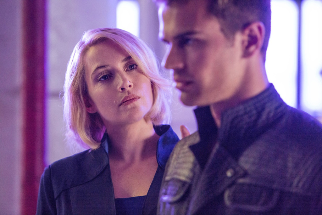 ". This image released by Summit Entertainment shows Kate Winslet, left, and Theo James in a scene from ""Divergent.\"" (AP Photo/Summit Entertainment, Jaap Buitendijk)"