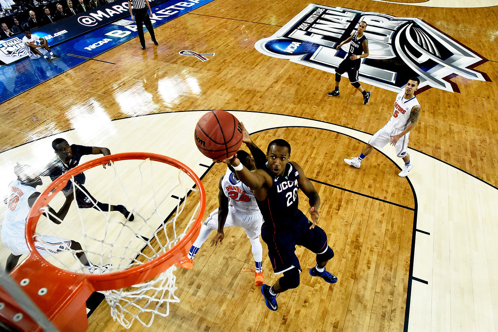. ARLINGTON, TX - APRIL 05:  Lasan Kromah #20 of the Connecticut Huskies goes to the basket against Casey Prather #24 of the Florida Gators during the NCAA Men\'s Final Four Semifinal at AT&T Stadium on April 5, 2014 in Arlington, Texas.  (Photo by Chris Steppig-Pool/Getty Images)