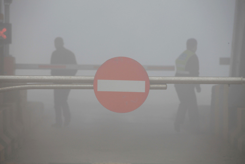 . A toll booth is shuttered as heavy smog spreads on a highway as vehicles are forced to wait due to heavy smog in Jilin, northeast China\'s Jilin province on October 22, 2013.    AFP PHOTOSTR/AFP/Getty Images