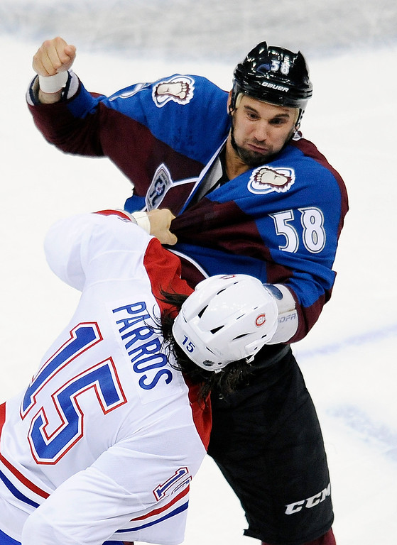 . Colorado Avalanche left wing Patrick Bordeleau, top, and Montreal Canadiens right wing George Parros, bottom, fight in the first period of an NHL hockey game on Saturday, Nov. 2, 2013, in Denver.  (AP Photo/Chris Schneider)