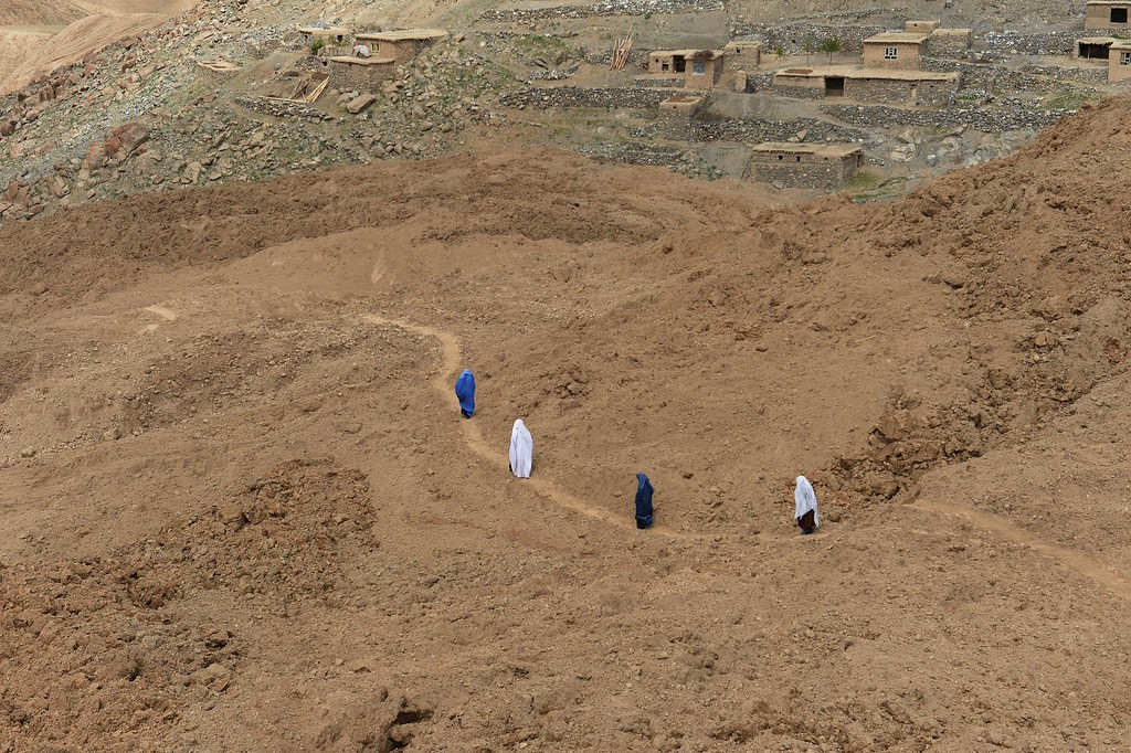 . Afghan villagers walk at the scene in the landslide-hit Aab Bareek village in Argo district of Badakhshan on May 5, 2014. Rescue teams abandoned the search for survivors May 3 after a landslide buried a hillside village in northern Afghanistan. At least 300 were killed, and officials warned the death toll could rise by hundreds more. A total of 700 families were left homeless in the mountains. AFP PHOTO/SHAH Marai /AFP/Getty Images