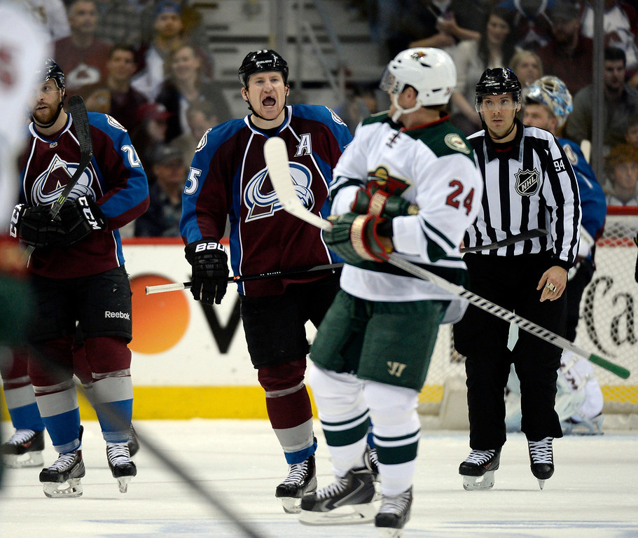 . Cody McLeod (55) of the Colorado Avalanche yells at Matt Cooke (24) of the Minnesota Wild during the first period of action. The Colorado Avalanche hosted the Minnesota Wild in the first round of the Stanley Cup Playoffs at the Pepsi Center in Denver, Colorado on Saturday, April 19, 2014. (Photo by John Leyba/The Denver Post)