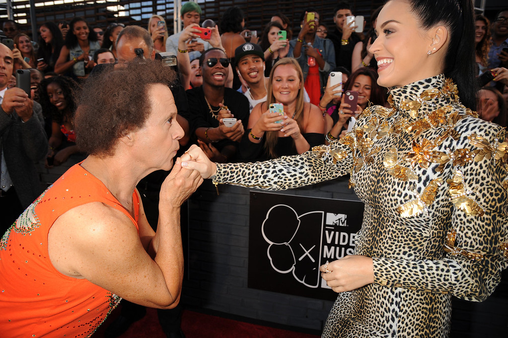 . Fitness guru Richard Simmons, left, kisses the hand of singer Katy Perry at the MTV Video Music Awards on Sunday, Aug. 25, 2013, at the Barclays Center in the Brooklyn borough of New York. (Photo by Scott Gries/Invision/AP)