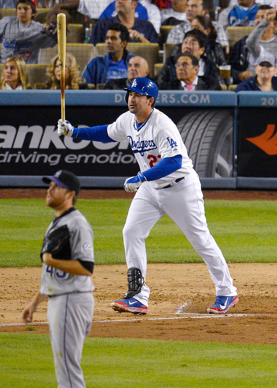 . Los Angeles Dodgers\' Adrian Gonzalez and Colorado Rockies starting pitcher Collin McHugh watch Gonzalez\'s solo home run during the third inning of a baseball game, Friday, Sept. 27, 2013, in Los Angeles. (AP Photo/Mark J. Terrill)