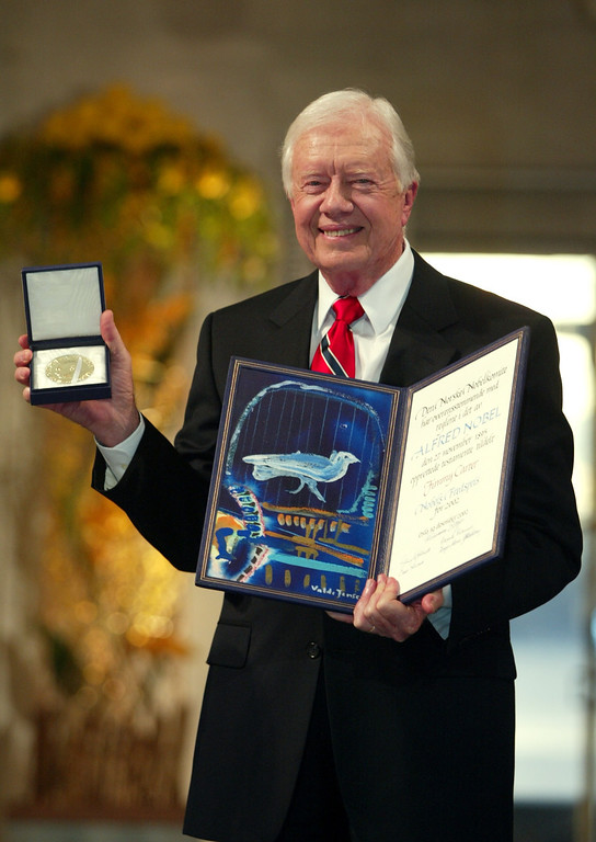 . Former President Jimmy Carter receives the 2002 Nobel Peace Prize in Oslo City Hall, Norway on Tuesday, Dec. 10, 2002. (AP Photo/Bjoern Sigurdsoen/Pool)