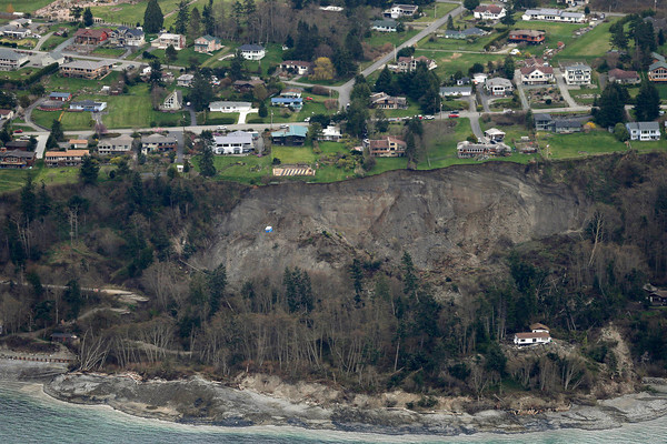 Photos: Landslide in Washington threatens 30 homes
