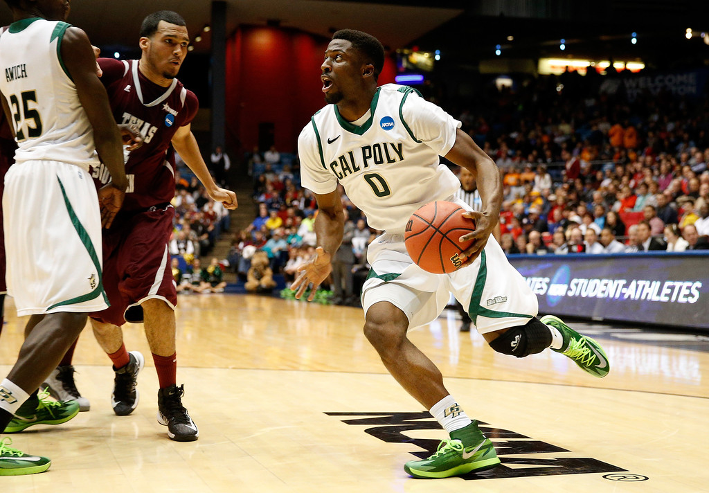 . DAYTON, OH - MARCH 19: Dave Nwaba #0 of the Cal Poly Mustangs drives to the basket against the Texas Southern Tigers during the first round of the 2014 NCAA Men\'s Basketball Tournament at UD Arena on March 19, 2014 in Dayton, Ohio.  (Photo by Gregory Shamus/Getty Images)