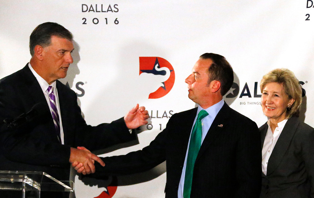 . Dallas Mayor Mike Rawlings, RNC chairman Reince Priebus and Senator Kay Bailey Hutchison are pictured during a press conference at the American Airlines Center, as they are courted by the city for the 2016 national convention, on Thursday, June 12, 2014.  (Louis DeLuca/Dallas Morning News)