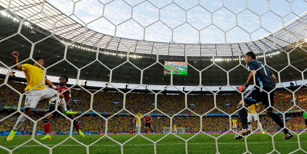 . Brazil\'s Thiago Silva, left, scores the opening goal during the World Cup quarterfinal soccer match between Brazil and Colombia at the Arena Castelao in Fortaleza, Brazil, Friday, July 4, 2014. (AP Photo/Manu Fernandez)