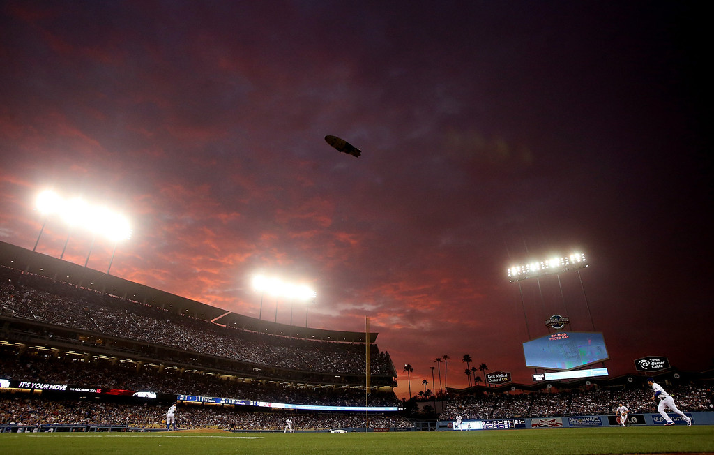 . A view of a sunset over the game between the Colorado Rockies and the Los Angeles Dodgers at Dodger Stadium on July 11, 2013 in Los Angeles, California.  (Photo by Stephen Dunn/Getty Images)