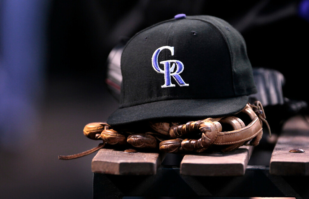 . Colorado Rockies center fielder Corey Dickerson\'s cap and glove lay in the dugout during the fourth inning of a baseball game against the New York Mets in Denver, Thursday, May 1, 2014. (AP Photo/Joe Mahoney)