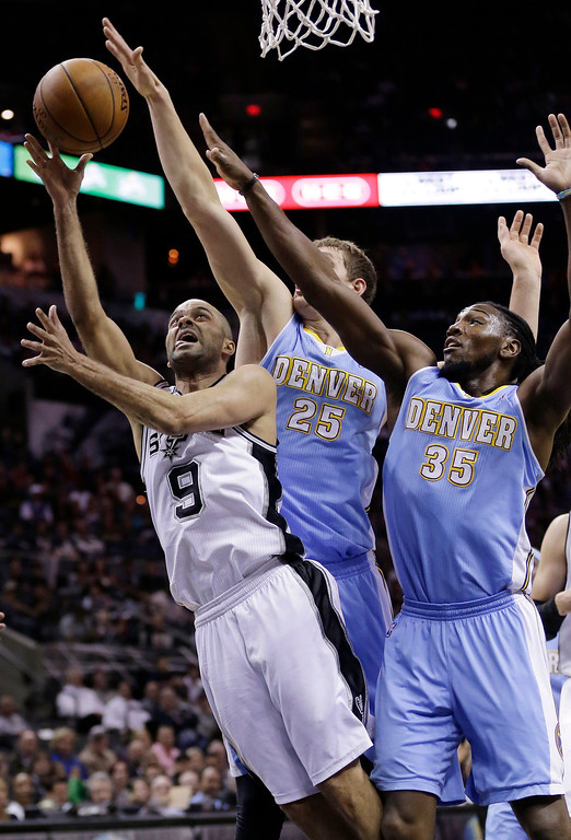 . San Antonio Spurs\' Tony Parker (9) scores past Denver Nuggets\' Timofey Mozgov (25) and Kenneth Faried (35) during the first half of an NBA basketball game, Wednesday, March 26, 2014, in San Antonio. (AP Photo/Eric Gay)