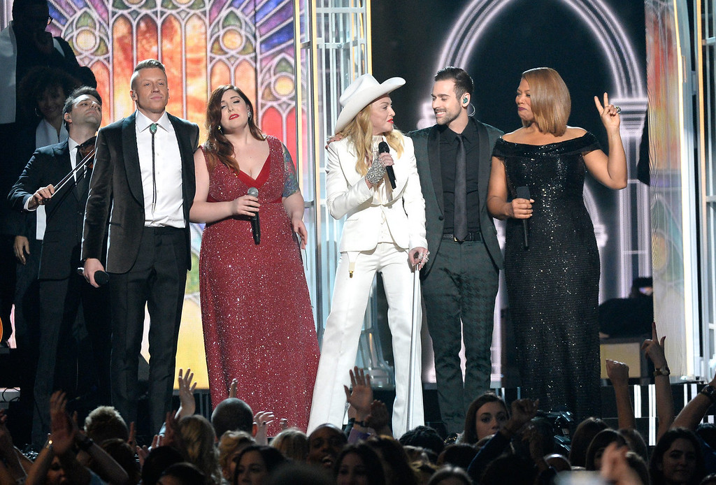 . (L-R) Rapper Macklemore, singers Mary Lambert and Madonna, musicians Ryan Lewis and Queen Latifah perform onstage during the 56th GRAMMY Awards at Staples Center on January 26, 2014 in Los Angeles, California.  (Photo by Kevork Djansezian/Getty Images)