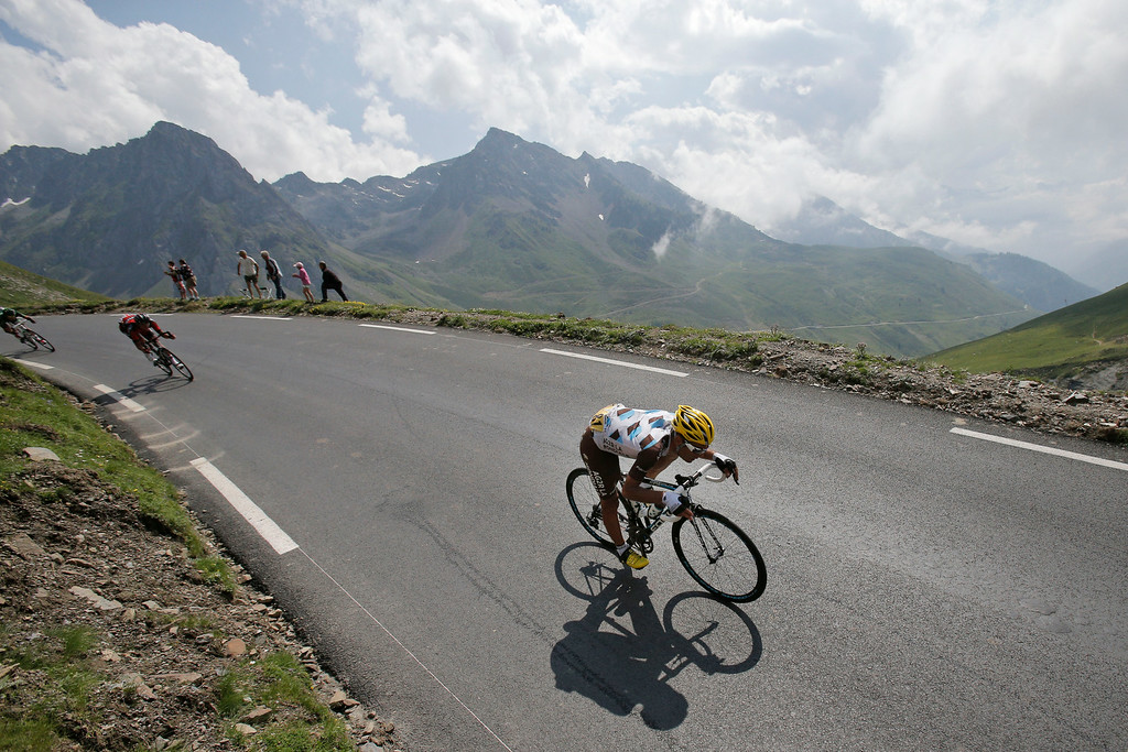 . France\'s Jean-Christophe Peraud, front, speeds down Tourmalet pass during the eighteenth stage of the Tour de France cycling race over 145.5 kilometers (90.4 miles) with start in Pau and finish in Hautacam, Pyrenees region, France, Thursday, July 24, 2014. (AP Photo/Christophe Ena)