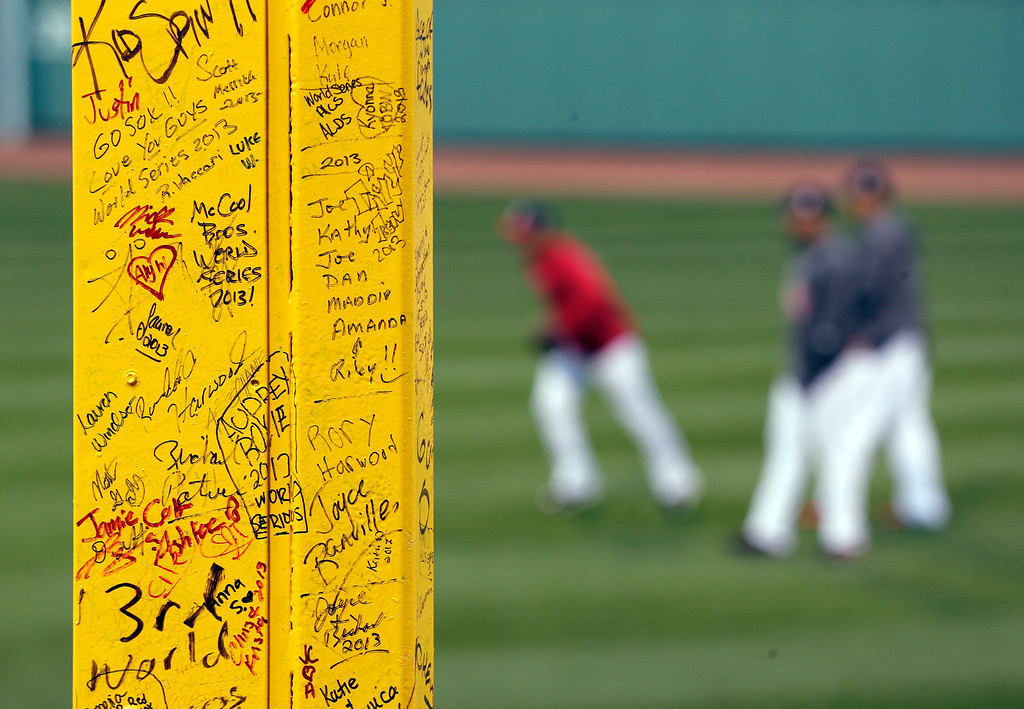 """. Fans\' signatures are seen on the \""""Pesky\'s Pole\"""" in the right field as the Boston Red Sox practice before Game 2 of baseball\'s World Series against the St. Louis Cardinals Thursday, Oct. 24, 2013, at Fenway Park in Boston. (AP Photo/Charlie Riedel)"""