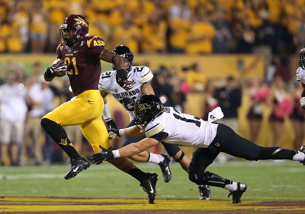 . TEMPE, AZ - OCTOBER 12:  Wide receiver Jaelen Strong #21 of the Arizona State Sun Devils runs with the football past defensive back Parker Orms #13 of the Colorado Buffaloes en route to scoring on a 69 yard touchdown reception during the first quarter of the college football game at Sun Devil Stadium on October 12, 2013 in Tempe, Arizona.  (Photo by Christian Petersen/Getty Images)