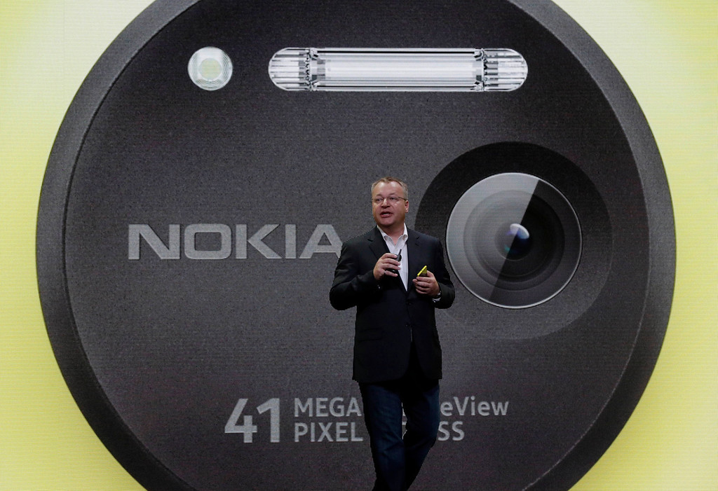 . Nokia CEO Stephen Elop desicribes his company\'s Nokia Lumia 1020, in New York,  Thursday, July 11, 2013.(AP Photo/Richard Drew)