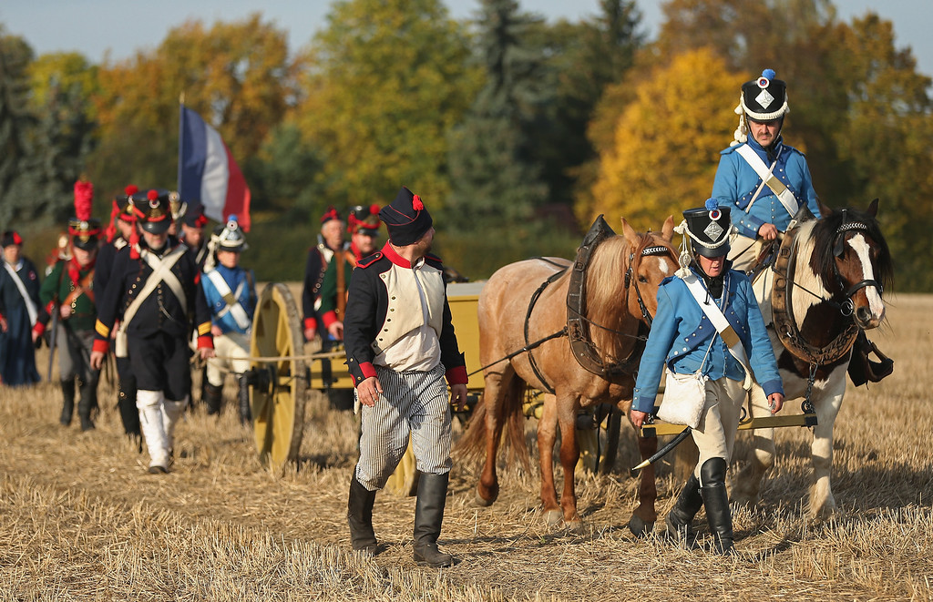 . Historical society enthusiasts in the role of French artillery soldiers fighting under Napoleon arrive to re-enact The Battle of Nations on its 200th anniversary on October 20, 2013 near Leipzig, Germany. (Photo by Sean Gallup/Getty Images)