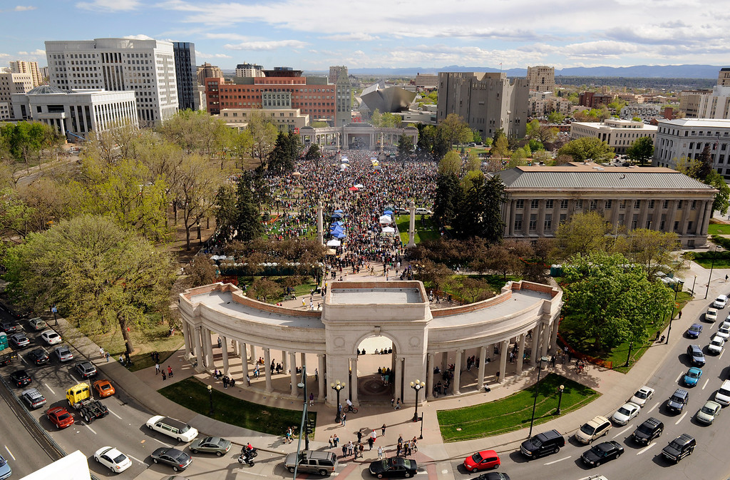. A cloud of smoke rises up above the crowd at the annual 4/20 rally in Civic Center in downtown Denver on Friday, April 20, 2012. Hundreds turned out for the annual day celebrating marijuana. (Daniel Petty, The Denver Post)