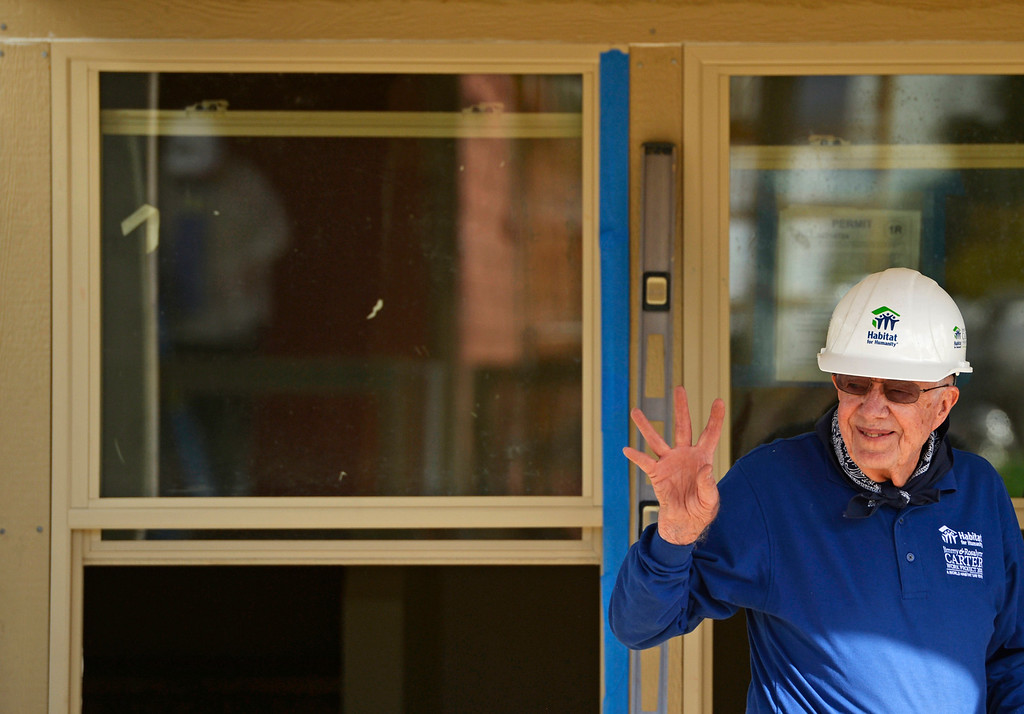 . DENVER, CO - OCTOBER 09: Former president Jimmy Carter waves to volunteers during Habitat for Humanity\'s Carter Work Project event in the Globeville Neighborhood in Denver, October 09, 2013. Since 1984 the former president and his wife have dedicated a week of their time to help build Habitat homes. (Photo By RJ Sangosti/The Denver Post)