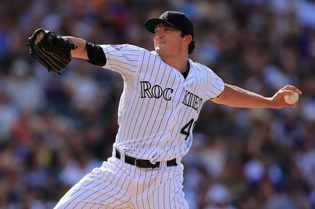 . Relief pitcher Rex Brothers #49 of the Colorado Rockies delivers against the Pittsburgh Pirates at Coors Field on August 11, 2013 in Denver, Colorado. Brothers earned a save as the Rockies defeated the Pirates 3-2 and swept the three game series.  (Photo by Doug Pensinger/Getty Images)