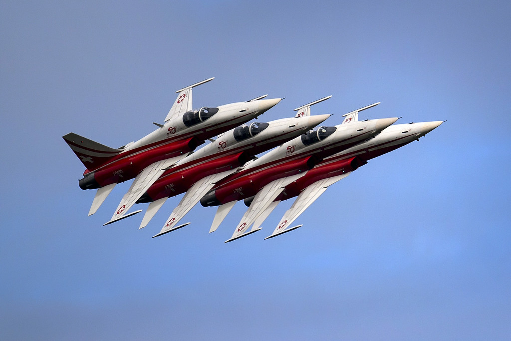 """. Fighter jets of the \""""Patrouille Suisse\"""" (Swiss patrol) perform on August 30, 2014 during the first day of AIR14 airshow in Payerne, western Switzerland.  AFP PHOTO / FABRICE  COFFRINI/AFP/Getty Images"""