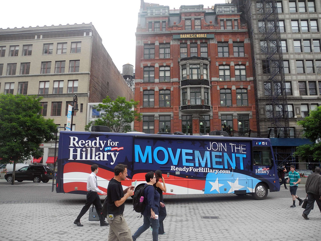 """. A bus passes in front of a Barnes & Noble  Bookseller store where former US Secretary of State Hillary Clinton greeted patrons for the signing of her new book, \""""Hard Choices\""""  on June 10, 2014, in New York. BRIGITTE DUSSEAU/AFP/Getty Images"""