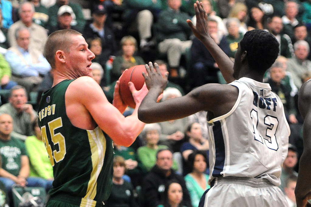 . Colorado State University senior Colton Iverson, left, works against Nevada\'s Cole Huff in the second half of their game on Saturday, March 9, 2013 at Moby Arena. Colorado State Defeated Nevada, 77-66.  Steve Stoner, Loveland Reporter-Herald