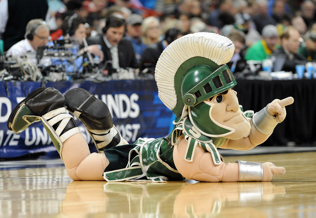 . The Michigan State Spartans mascot cheers on his team during their game against the Delaware Fightin Blue Hens in the second round of the 2014 NCAA Men\'s Basketball Tournament at Spokane Veterans Memorial Arena on March 20, 2014 in Spokane, Washington.  (Photo by Steve Dykes/Getty Images)