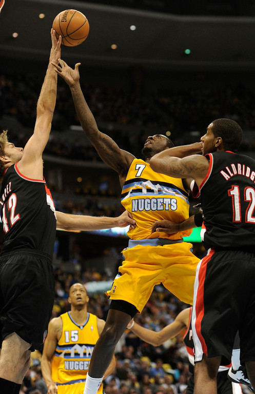 . DENVER, CO. - NOVEMBER 1:  Portland center Robin Lopez (42) rejected Denver forward J.J. Hickson (7) in the lane in the first half. The Denver Nuggets hosted the Portland Trail Blazers Friday night, November 1, 2013 at the Pepsi Center.  Photo By Karl Gehring/The Denver Post