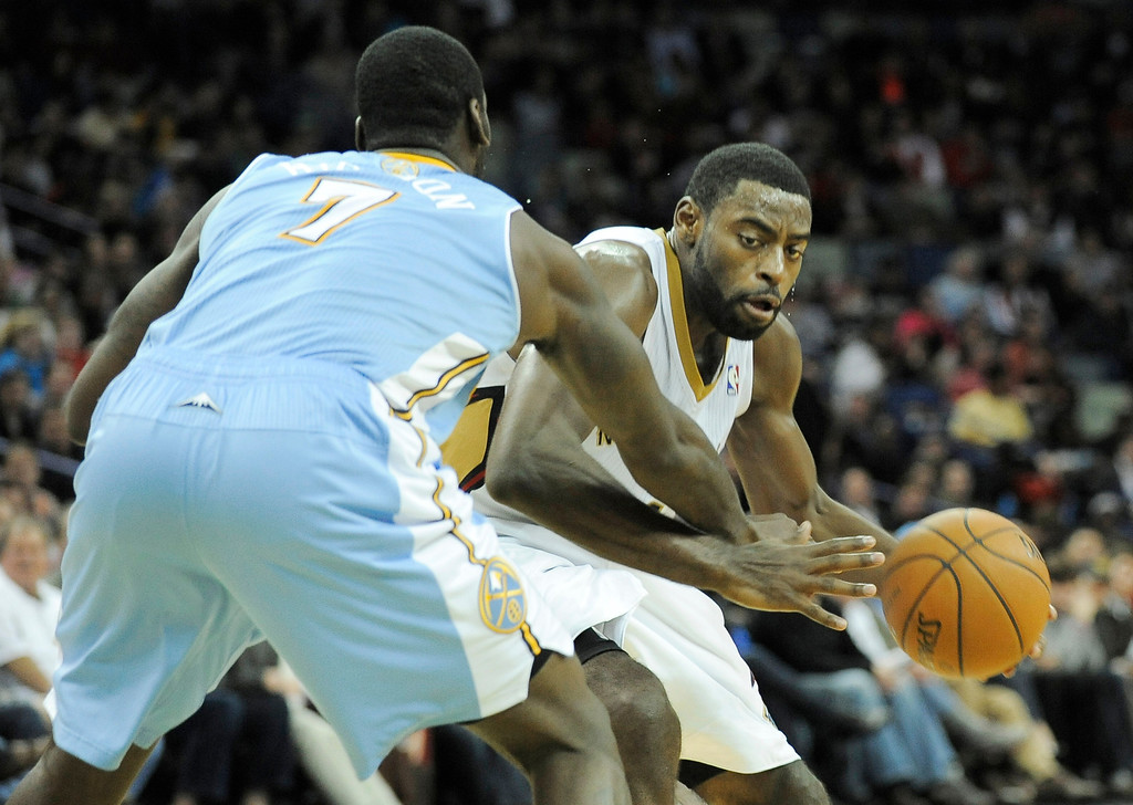 . New Orleans Pelicans guard Tyreke Evans, right, drives to the basket against Denver Nuggets forward J.J. Hickson (7) in the second half of an NBA basketball game in New Orleans, Friday, Dec. 27, 2013. New Orleans won 105-89. (AP Photo/Stacy Revere)
