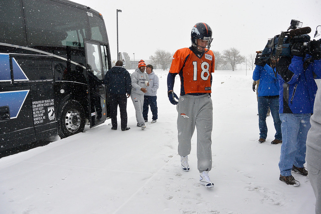. ENGLEWOOD, CO - DECEMBER 4: Denver Broncos quarterback Peyton Manning (18) heads to the bubble for November 4, 2013 at Dove Valley (Photo by John Leyba/The Denver Post)