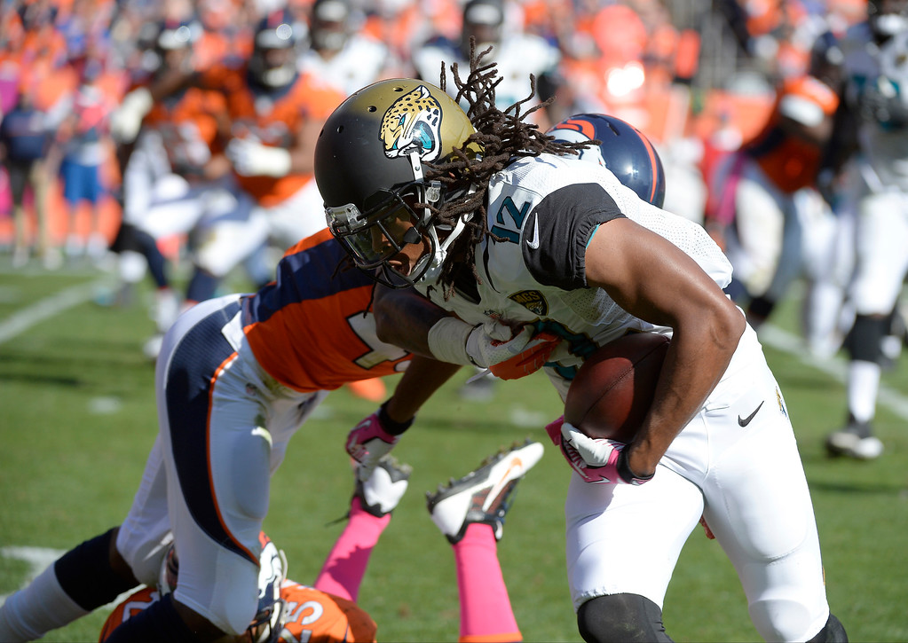 . Jacksonville Jaguars wide receiver Mike Brown (12) breaks a tackle in the second quarter against the Denver Broncos.   (Photo by John Leyba/The Denver Post)