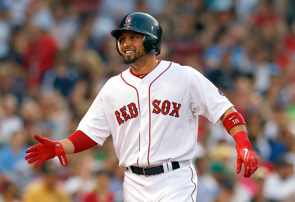 . Shane Victorino #18 of the Boston Red Sox smiles after he scored in the 2nd inning against the Colorado Rockies at Fenway Park on June 25, 2013 in Boston, Massachusetts.  (Photo by Jim Rogash/Getty Images)