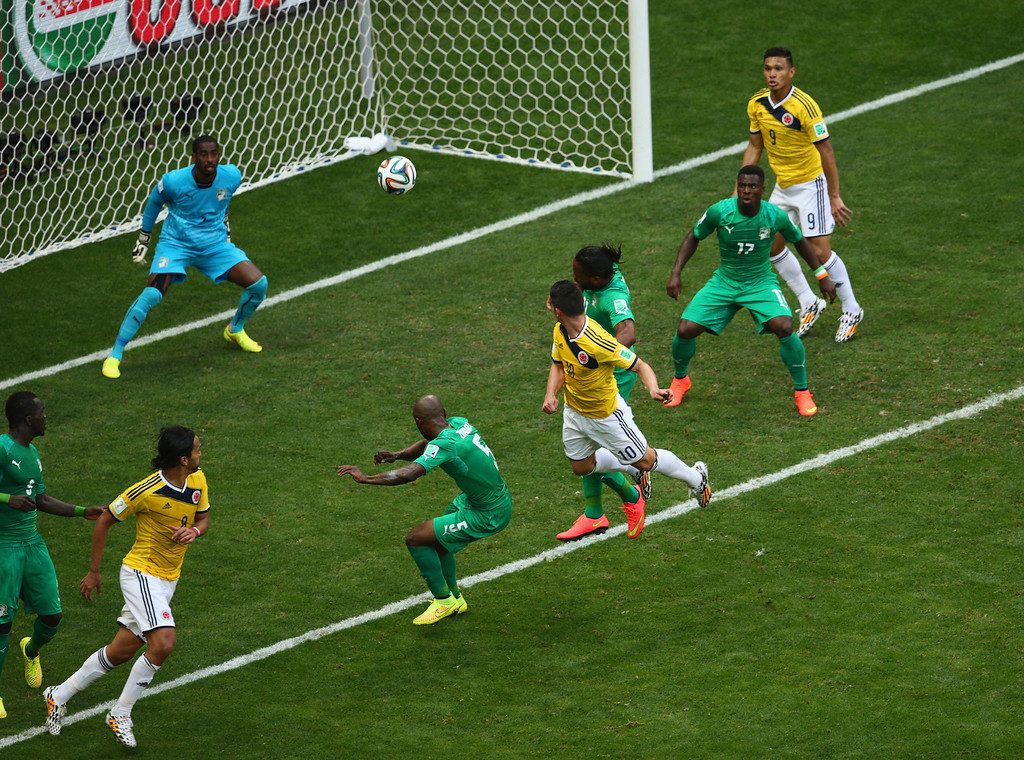 . James Rodriguez of Colombia scores his team\'s first goal on a header past goalkeeper Boubacar Barry of the Ivory Coast during the 2014 FIFA World Cup Brazil Group C match between Colombia and Cote D\'Ivoire at Estadio Nacional on June 19, 2014 in Brasilia, Brazil.  (Photo by Adam Pretty/Getty Images)