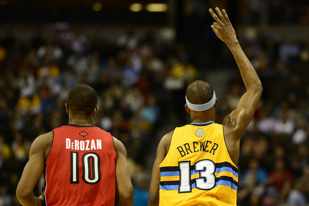 . Denver Nuggets player Corey Brewer signals a three pointer he made over Toronto Raptors player DeMar DeRozan during the first half at the Pepsi Center on Monday, December 3, 2012. AAron Ontiveroz/The Denver Post