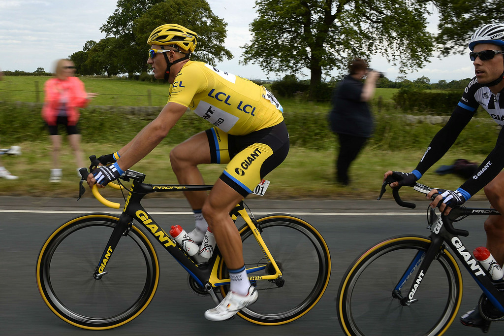 . Germany\'s Marcel Kittel wearing the overall leader\'s yellow jersey rides in the pack during the 201 km second stage of the 101th edition of the Tour de France cycling race on July 6, 2014 between York and Sheffield, northern England.  AFP PHOTO / ERIC FEFERBERGERIC FEFERBERG/AFP/Getty Images
