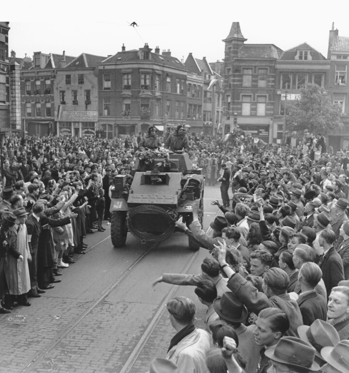 . A large crowd of Utrecht citizens gathers in the streets of the Dutch city, on May 7, 1945, to welcome the liberating Allied troops in their hometown. (AP Photo)