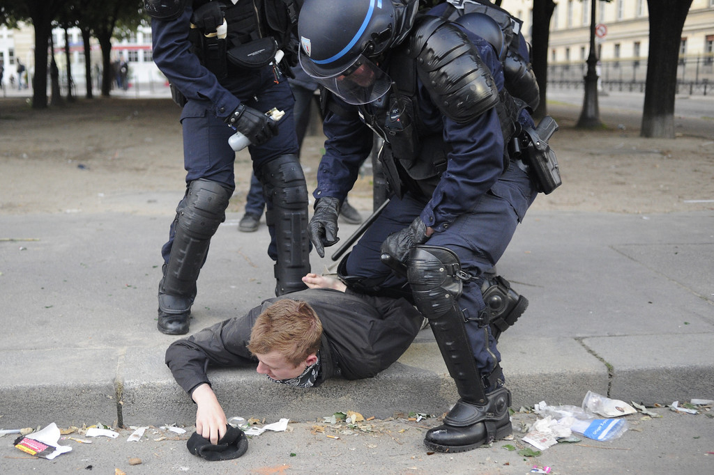 . Riot policemen arrest a far-right protester on May 26, 2013 in Paris on the sidelines of the demonstrations against a gay marriage law. France on May 18 became the 14th country to legalize same-sex marriage after President Francois Hollande signed the measure into law following months of bitter debate and demonstrations. Tens of thousands marched through Paris today to protest a new gay marriage law, with police on high alert amid warnings hardliners could infiltrate the demonstration and cause trouble.   FRED DUFOUR/AFP/Getty Images