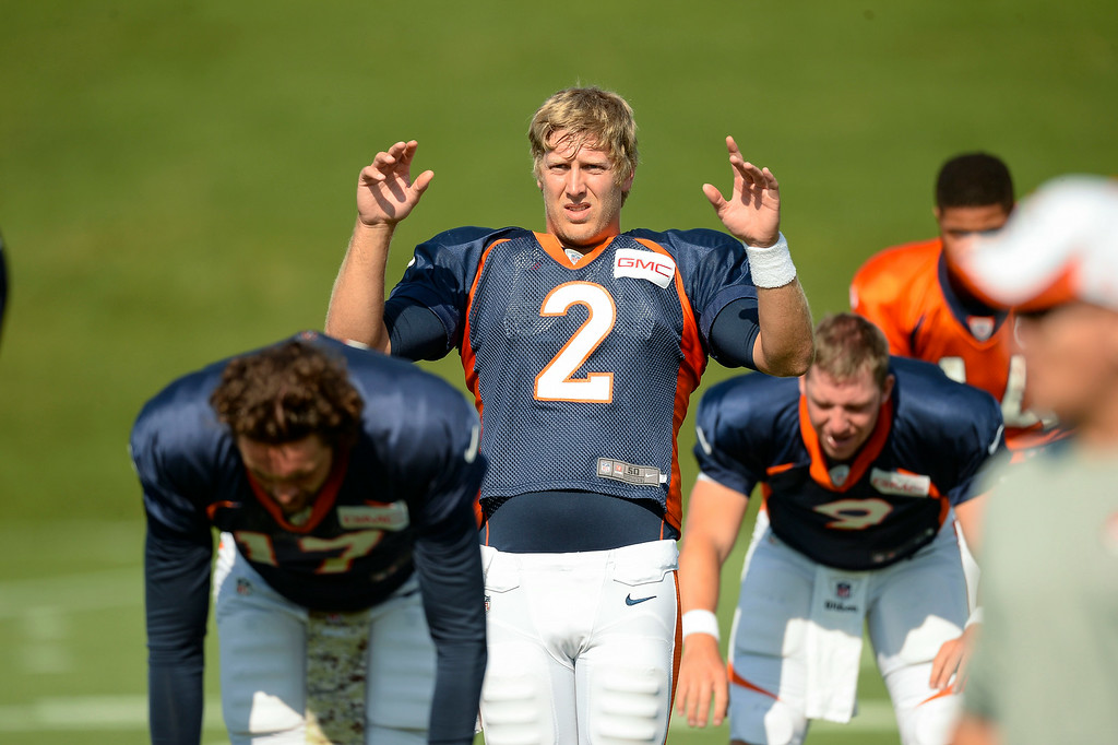 . Denver Broncos quarterback Zac Dysert (2) stretches on day five of the Denver Broncos 2014 training camp July 28, 2014 at Dove Valley. (Photo by John Leyba/The Denver Post)