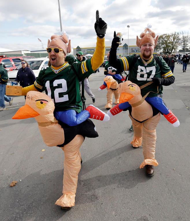 . Brad Zeman, left, and Zack Zeman make their way around Lambeau Field before an NFL football game between the Green Bay Packers and the Philadelphia Eagles Sunday, Nov. 10, 2013, in Green Bay, Wis. (AP Photo/Mike Roemer)