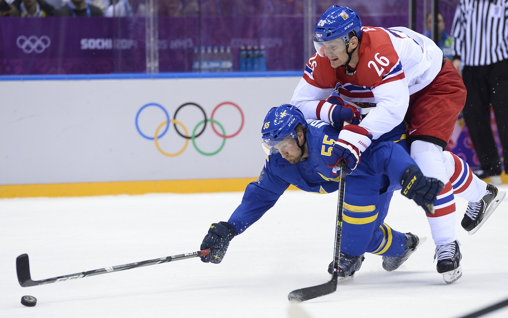 . Sweden\'s Niklas Kronwall (L) vies with Czech Republic\'s Patrik Elias during the Men\'s Ice Hockey Group B match Czech Republic vs Sweden at the Bolshoy Ice Dome on February 12, 2014 at the Sochi Winter Olympics in Sochi.    JONATHAN NACKSTRAND/AFP/Getty Images