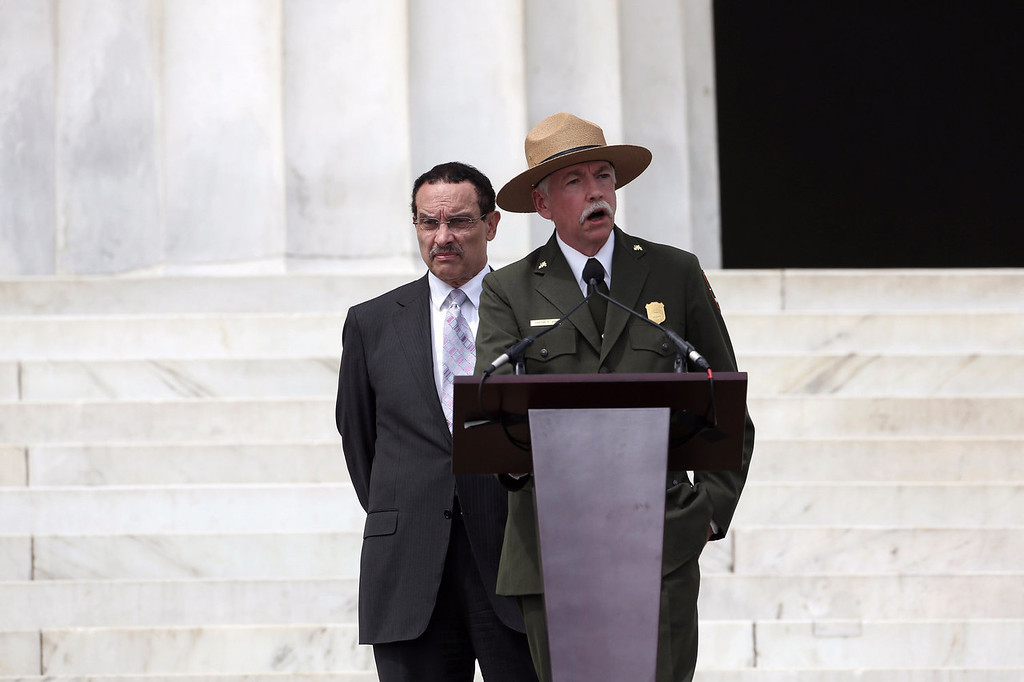 """. Director of the National Park Service Jonathan Jarvis (R) speaks as Washington, D.C. Mayor Vincent Gray listens during the Let Freedom Ring ceremony at the Lincoln Memorial August 28, 2013 in Washington, DC. The event was to commemorate the 50th anniversary of Dr. Martin Luther King Jr.\'s \""""I Have a Dream\"""" speech and the March on Washington for Jobs and Freedom.  (Photo by Alex Wong/Getty Images)"""