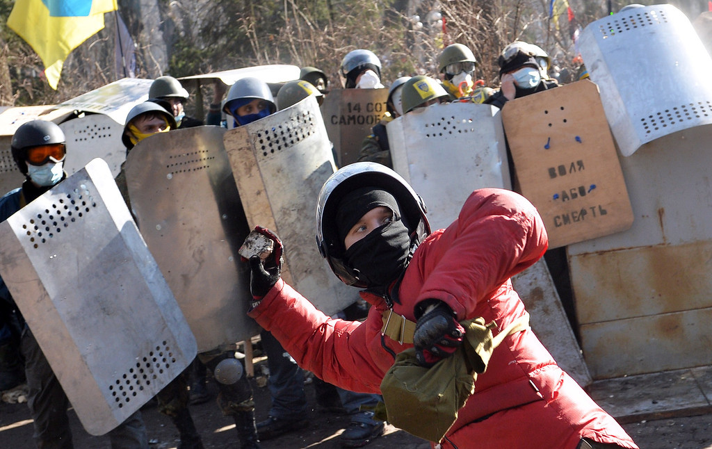 . An anti-government protester prepares to throw a brick during clashes with riot police in front of the Parliament in Kiev on February 18, 2014. AFP PHOTO / SERGEI  SUPINSKY/AFP/Getty Images