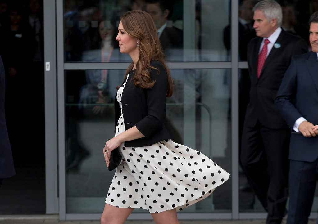 """. Kate the Duchess of Cambridge, her husband Prince William and his brother Prince Harry, both not pictured, leave after attending the inauguration of \""""Warner Bros. Studios Leavesden\"""" near Watford, approximately 18 miles north west of central London, Friday, April 26, 2013. (AP Photo/Matt Dunham)"""