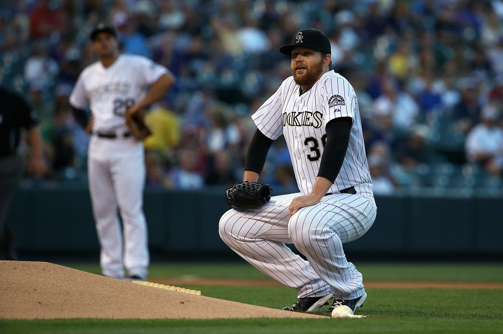 . DENVER, CO - AUGUST 05:  Starting pitcher Brett Anderson #30 of the Colorado Rockies reacts as he suffers an injury and leaves the game against the Chicago Cubs in the fourth inning at Coors Field on August 5, 2014 in Denver, Colorado.  (Photo by Doug Pensinger/Getty Images)