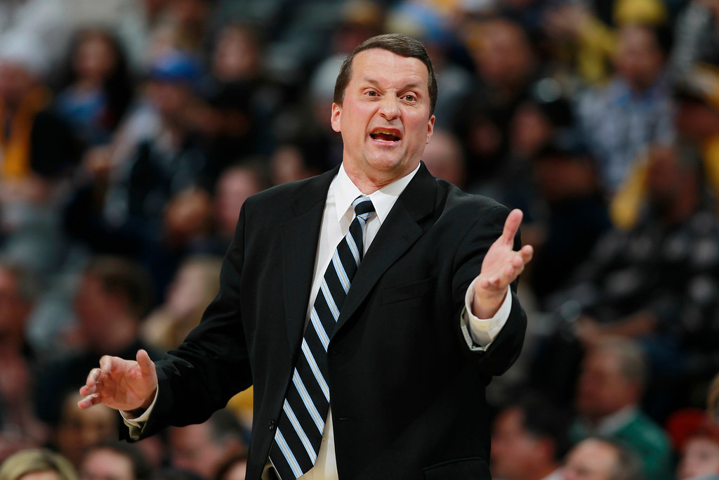 . Detroit Pistons head coach John Loyer argues a call against his team while facing the Denver Nuggets in the third quarter of the Nuggets\' 118-109 victory in an NBA basketball game in Denver on Wednesday, March 19, 2014. (AP Photo/David Zalubowski)