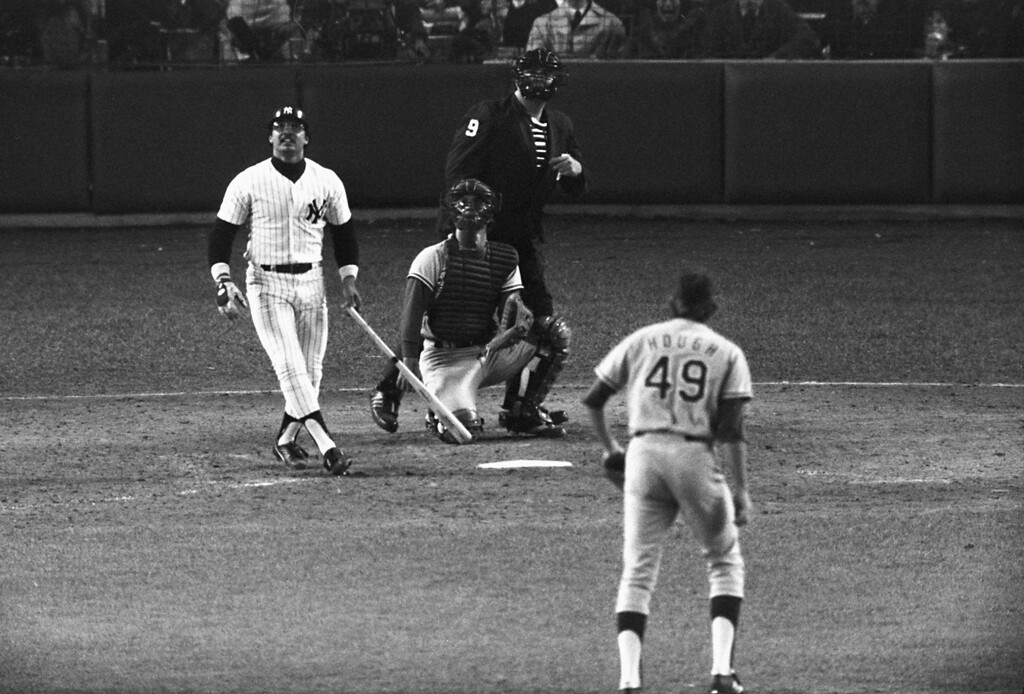 . Yankees\' slugger Reggie Jackson watches the path of his third home run in the eighth inning off a pitch from the Dodgers\' Charlie Hough during game 6 of the World Series against the Los Angeles Dodgers at Yankee Stadium in New York on Oct. 18, 1977.  New York won the game 8-4, for their 21st World Series championship.  (AP Photo)